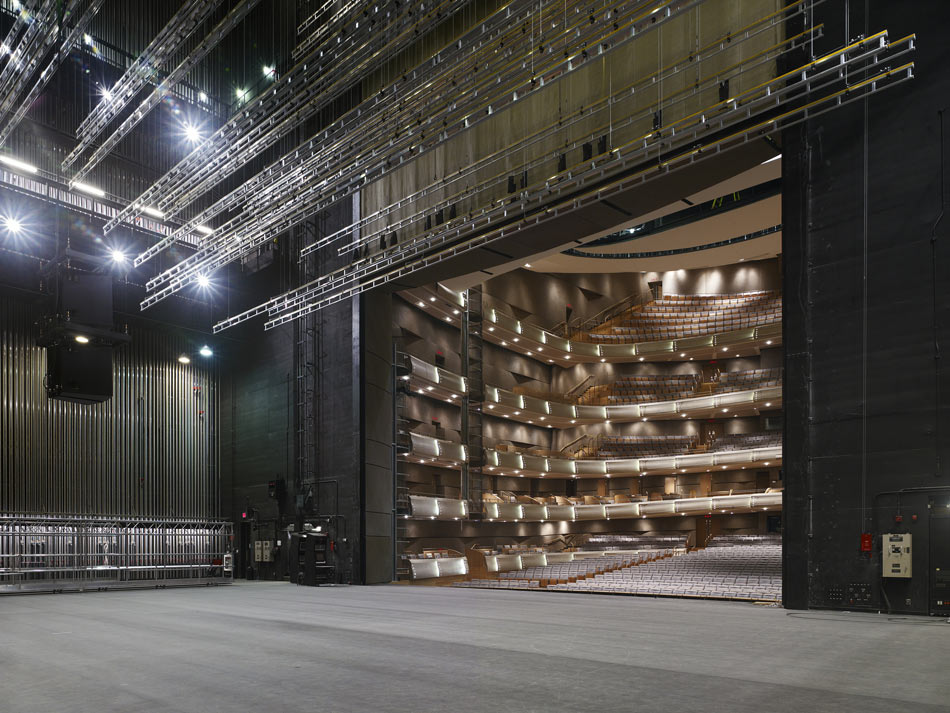 "A stage is more like an industrial work area, where equipment moves and changes frequently.  Beyond the ""fourth wall"" the audience sits in elegant comfort.  The Four Seasons Center for the Performing Arts, Toronto, Canada. Photography by Tim Griffith"