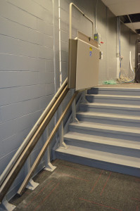 This control booth, under construction, utilizes a wheelchair lift to resolve accessibility.  This is just one way to provide accessibility.