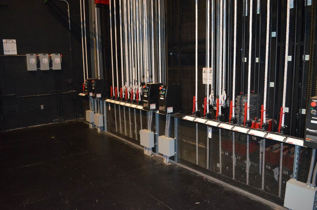 A high school stage with a combination of manual counterweight rigging and a few motorized linesets for heavy loads. Photo by Paul G. Sanow, ASTC