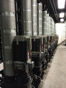 Machine Room at Alley Theatre, Houston, TX.  Variable, high speed hoists are installed along the wall of the theatre. Photo by Paul G. Sanow ASTC