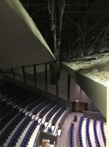 View of a modern LED house light installed between the reflectors of a high school theatre, during construction.  Photo by Andrew Gibbs, PhD, ASTC