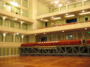 Schermerhorn Hall, View of seating section prepared to move toward stage and lift to lower level during transition.  Photo Courtesy of Bob Campbell ASTC